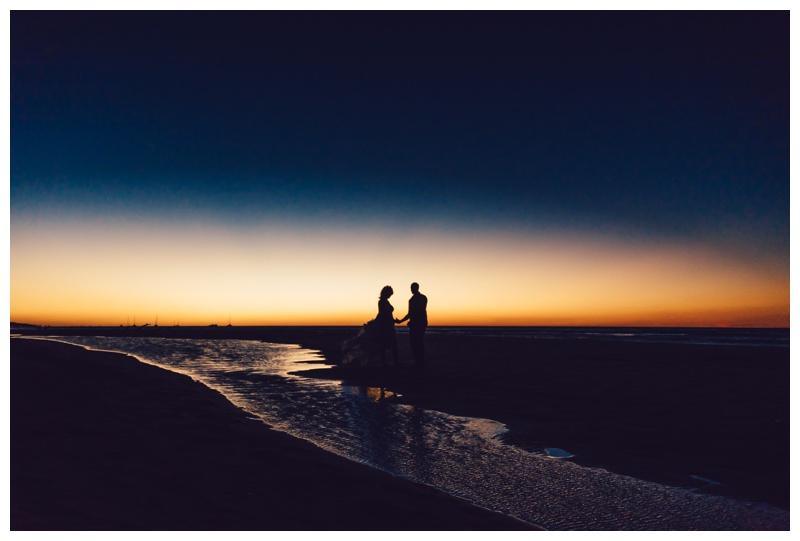 Bride and groom on the beach during sunset in Tamarindo Costa Rica. Photographed by Kristen M. Brown, Samba to the Sea Photography.