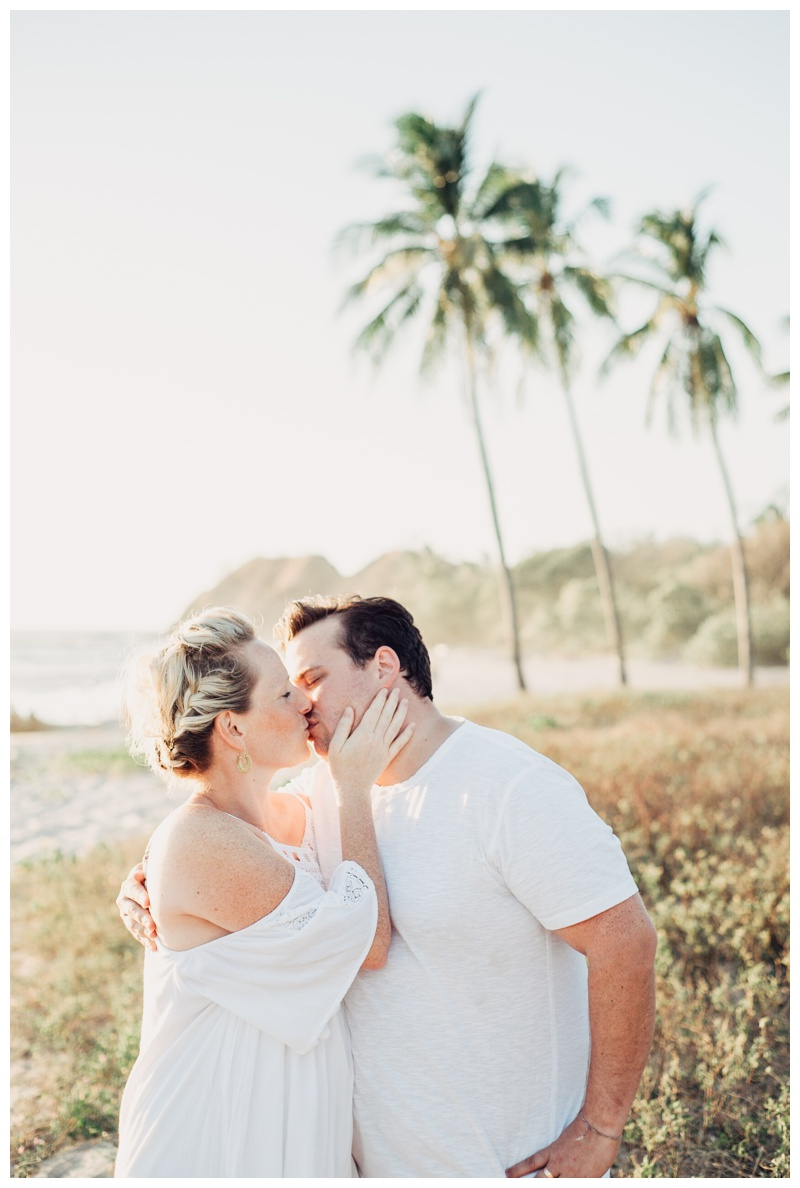 Couple kissing on the beach in Nosara Costa Rica. Photographed by Kristen M. Brown, Samba to the Sea Photography.
