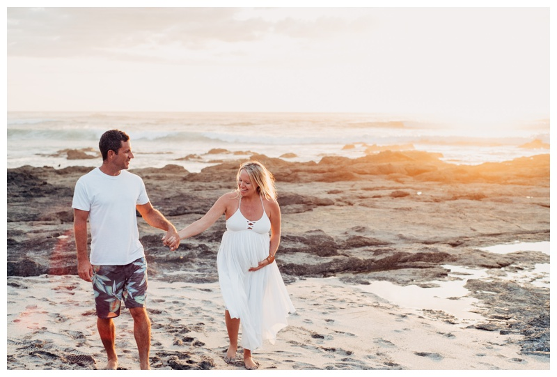 Couple walking on the beach during golden hour in Tamarindo Costa Rica. Photographed by Kristen M. Brown, Samba to the Sea Photography.