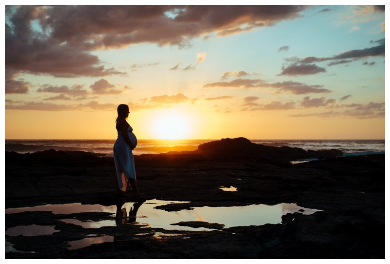 Pregnant woman standing on the beach during sunset in Tamarindo Costa Rica. Photographed by Kristen M. Brown, Samba to the Sea Photography.