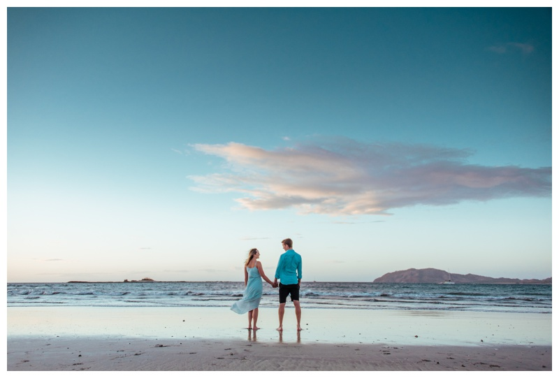Couple on the beach during sunset in Tamarindo Costa Rica. Photographed by Kristen M. Brown, Samba to the Sea Photography.