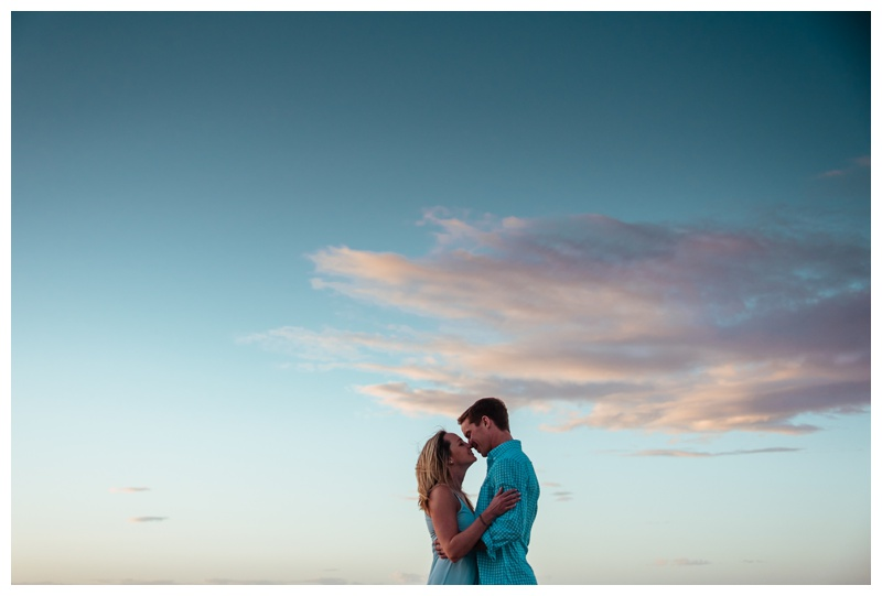 Couple kissing on the beach during sunset in Tamarindo Costa Rica. Photographed by Kristen M. Brown, Samba to the Sea Photography.