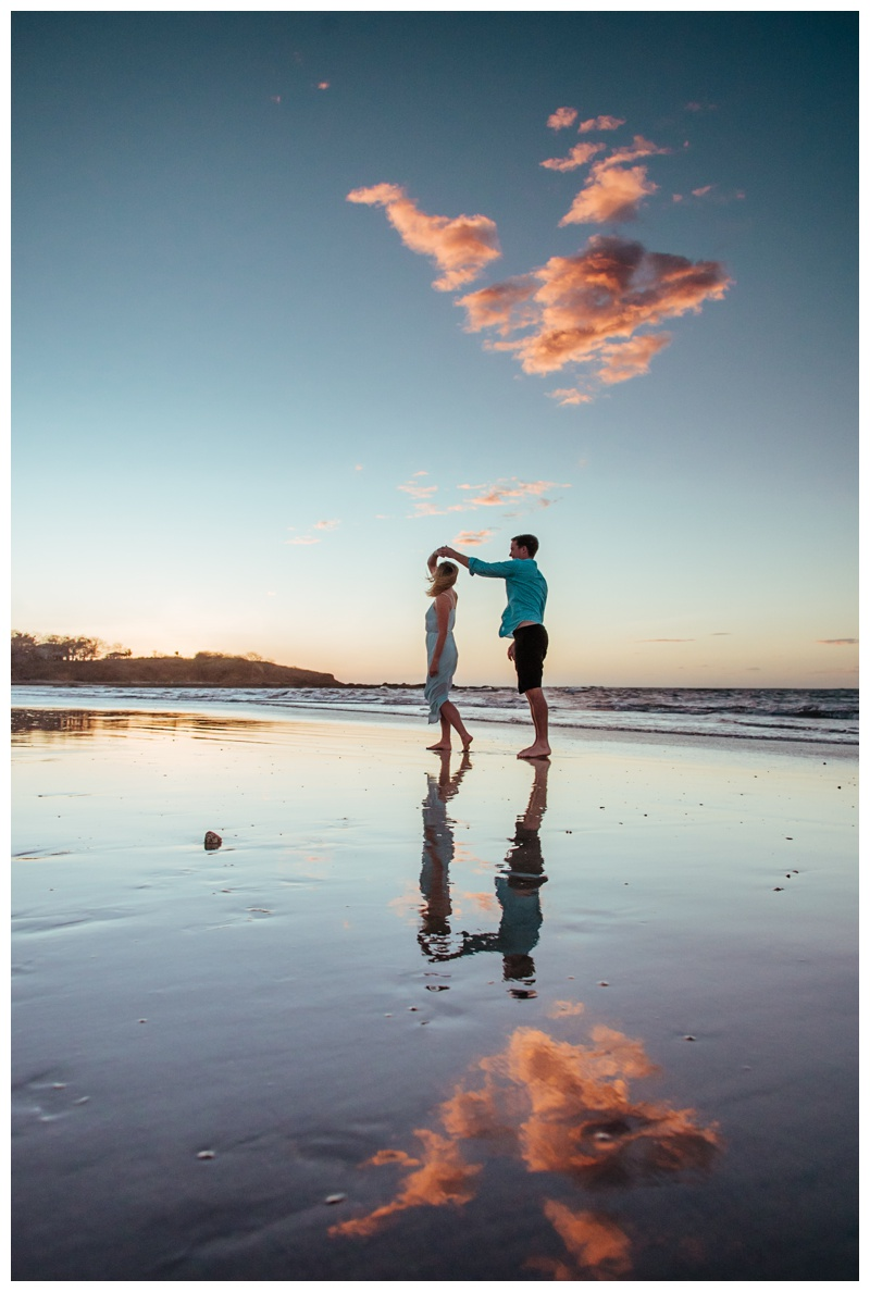Couple dancing on the beach during sunset in Tamarindo Costa Rica. Photographed by Kristen M. Brown, Samba to the Sea Photography.