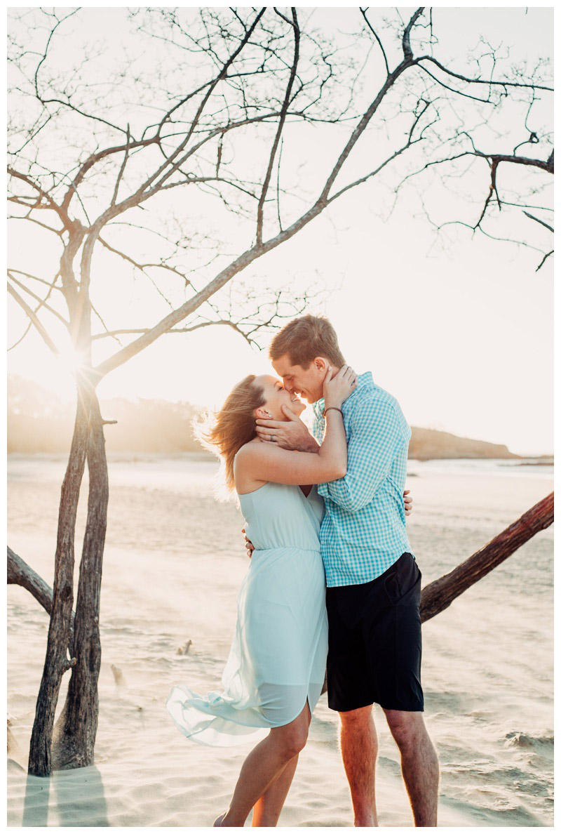Couple kissing on the beach in Tamarindo Costa Rica. Photographed by Kristen M. Brown, Samba to the Sea Photography.