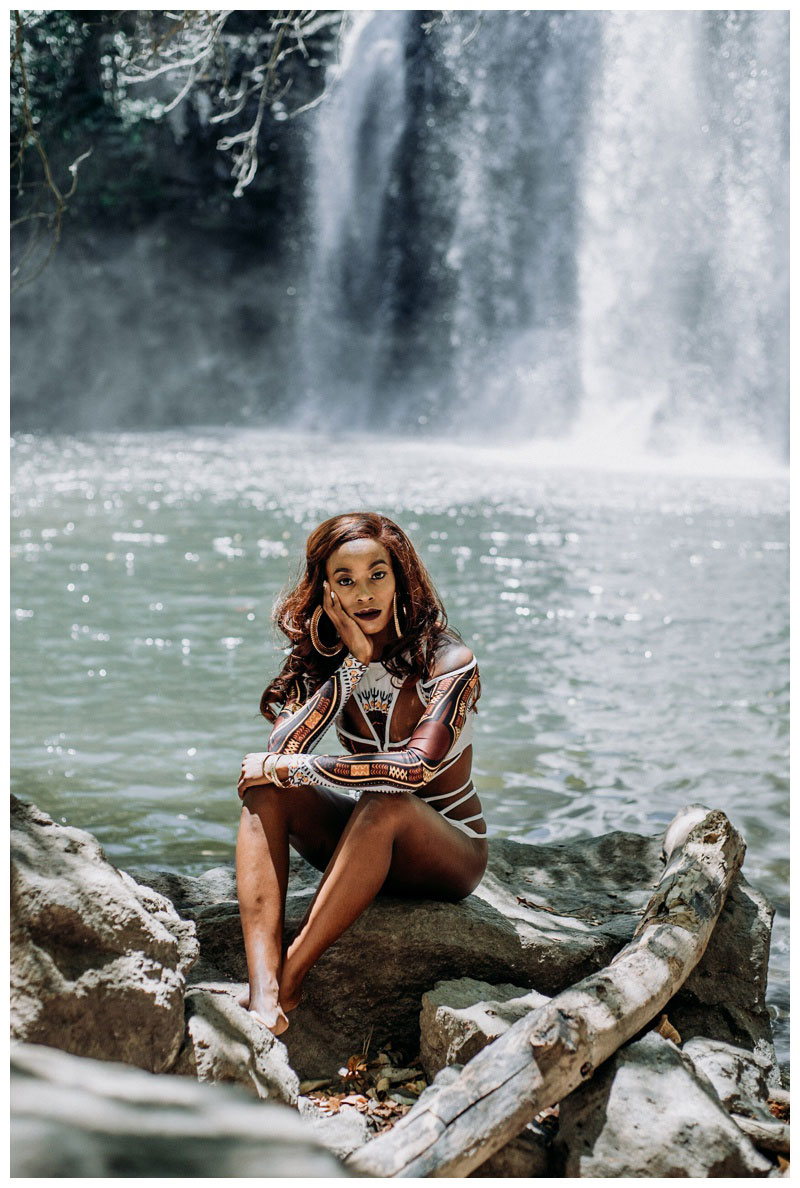 Photos at Llanos de Cortes waterfall in Costa Rica. Woman wearing one piece bathing suit BFYNE. Photographed by Kristen M. Brown, Samba to the Sea Photography.