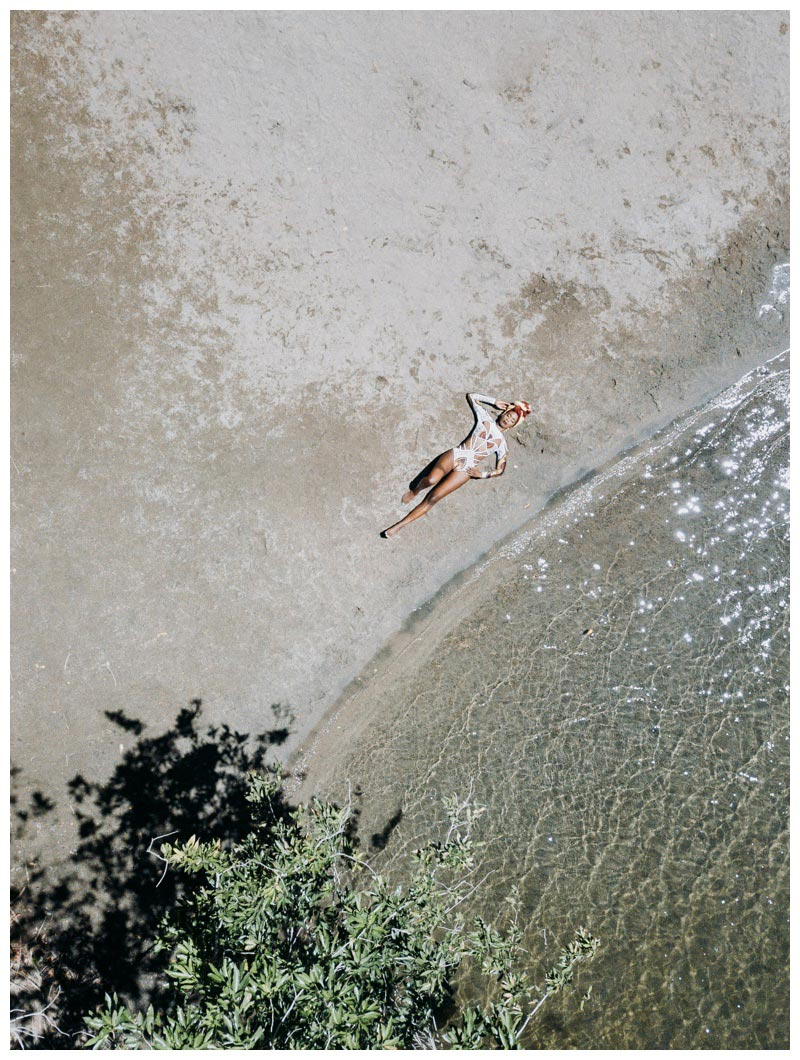 Aerial photo at Llanos de Cortes waterfall in Costa Rica. Woman wearing one piece bathing suit BFYNE. Photographed by Kristen M. Brown, Samba to the Sea Photography.