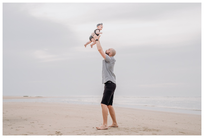 Father throwing his baby girl in the air on the beach in Tamarindo Costa Rica. Photographed by Kristen M. Brown, Samba to the Sea Photography.