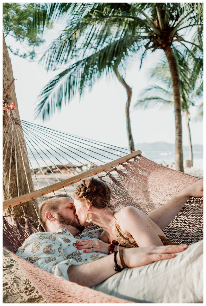 Couple kissing in a hammock on beach in Tamarindo Costa Rica. Photographed by Kristen M. Brown, Samba to the Sea Photography.