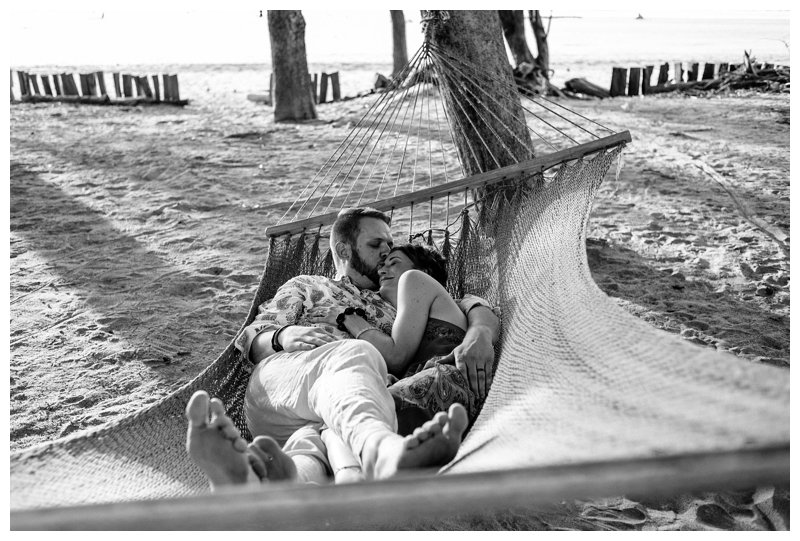 Couple laying in a hammock on beach in Tamarindo Costa Rica. Photographed by Kristen M. Brown, Samba to the Sea Photography.