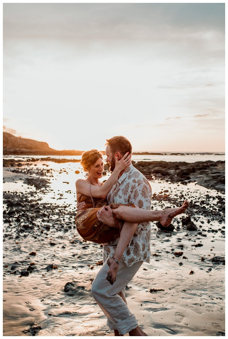 Husband and wife having fun on the beach during sunset in Tamarindo Costa Rica. Photographed by Kristen M. Brown, Samba to the Sea Photography.
