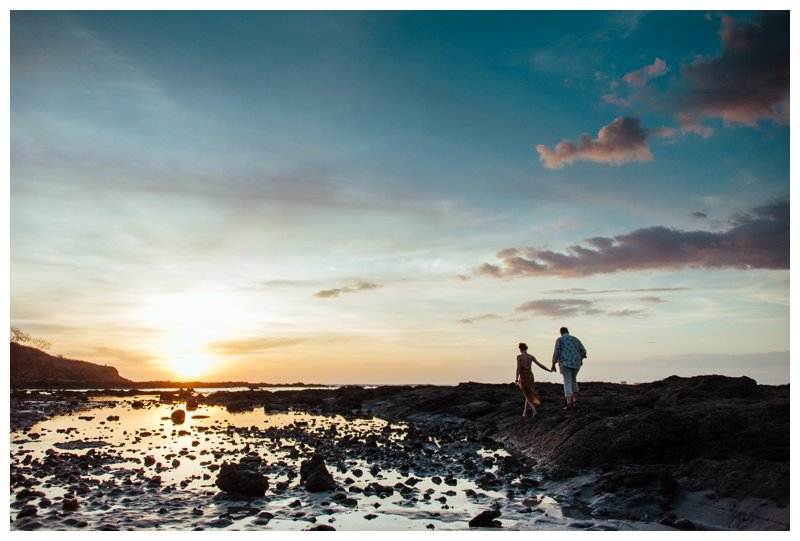 Couple walking on the beach during sunset in Tamarindo Costa Rica. Photographed by Kristen M. Brown, Samba to the Sea Photography.