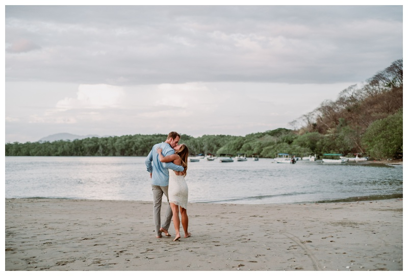 Husband and wife kissing on the beach after wedding in Tamarindo Costa Rica. Photographed by Kristen M. Brown, Samba to the Sea Photography.