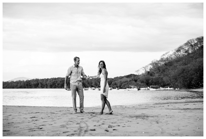 Husband and wife laughing on the beach after wedding in Tamarindo Costa Rica. Photographed by Kristen M. Brown, Samba to the Sea Photography.