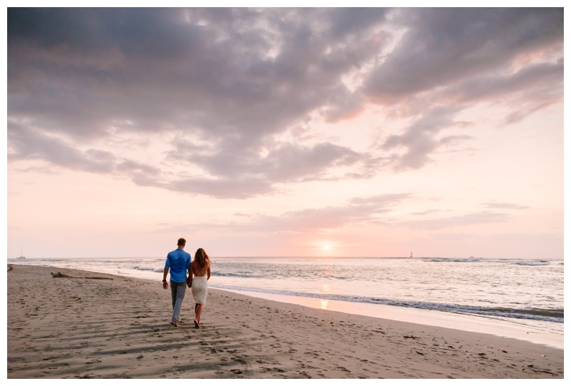 Bride and groom walking on the beach during sunset in Tamarindo Costa Rica. Photographed by Kristen M. Brown, Samba to the Sea Photography.
