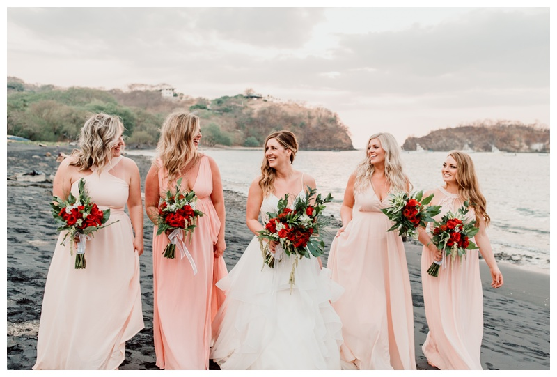 Bride and her bridesmaids on the beach after wedding in Playa Ocotal Costa Rica. Photographed by Kristen M. Brown, Samba to the Sea Photography.