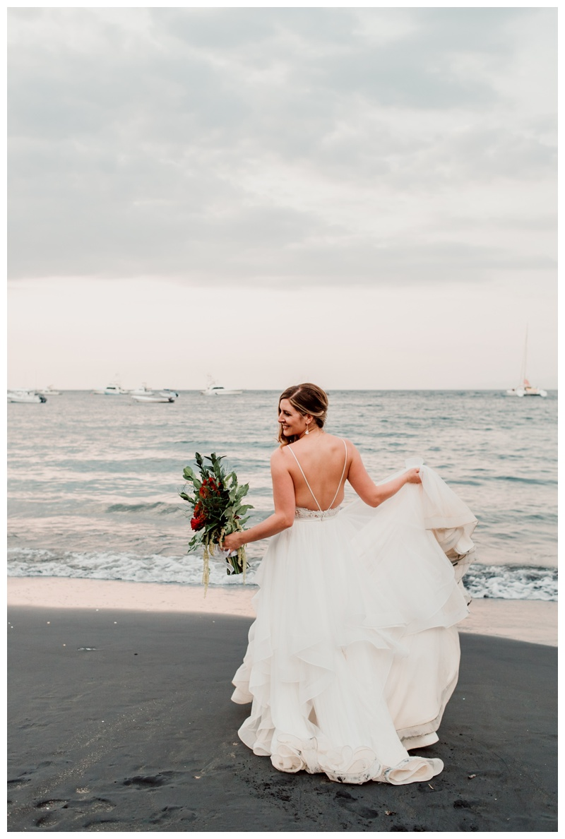 Bride on the beach after wedding in Playa Ocotal Costa Rica. Photographed by Kristen M. Brown, Samba to the Sea Photography.