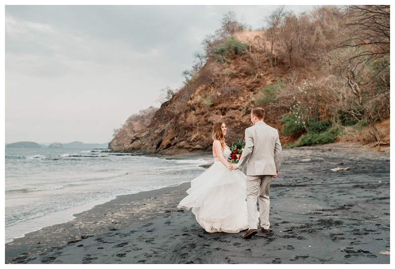 Bride and groom on the beach after their wedding in Playa Ocotal Costa Rica. Photographed by Kristen M. Brown, Samba to the Sea Photography.
