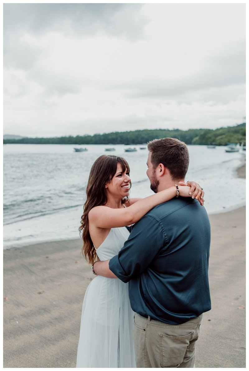 Bride and groom on the beach after their beach elopement in Costa Rica. Photographed by Kristen M. Brown, Samba to the Sea Photography.