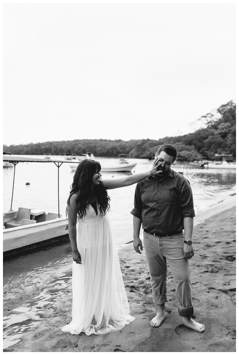 Couple joking around after their beach elopement in Costa Rica. Photographed by Kristen M. Brown, Samba to the Sea Photography.