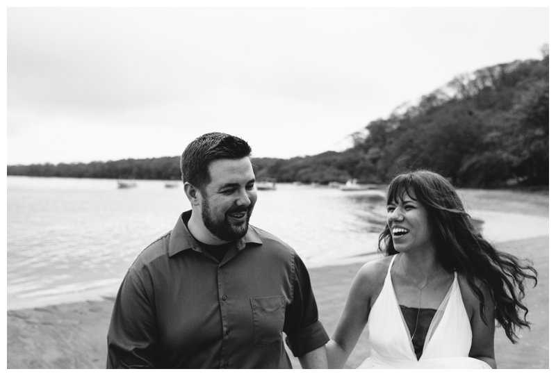 Couple laughing after their beach elopement in Costa Rica. Photographed by Kristen M. Brown, Samba to the Sea Photography.