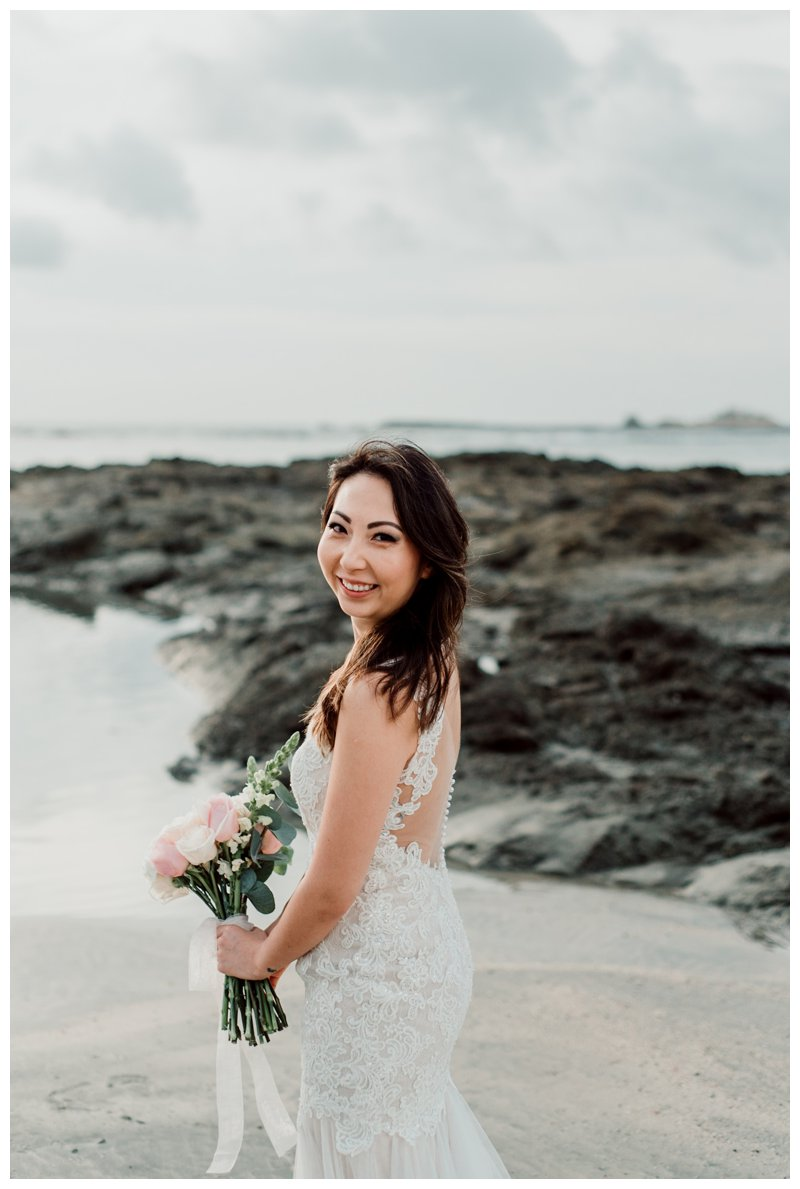 Bride on the beach in Tamarindo Costa Rica. Photographed by Kristen M. Brown, Samba to the Sea Photography.
