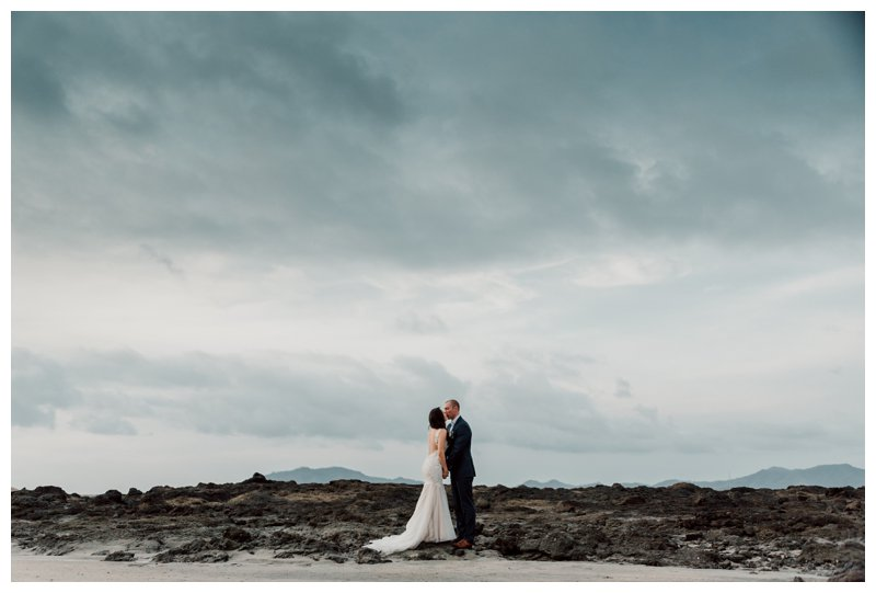 Bride and groom on the beach in Tamarindo Costa Rica. Photographed by Kristen M. Brown, Samba to the Sea Photography.