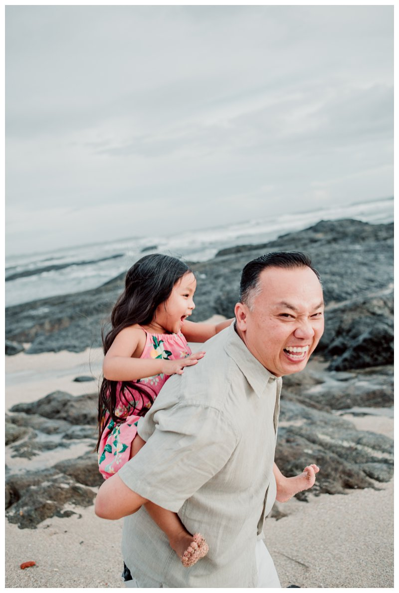 Dad giving his daughter a piggy back ride during their Calu Luna Playa Langosta Costa Rica family photos. Photographed by Kristen M. Brown, Samba to the Sea Photography.