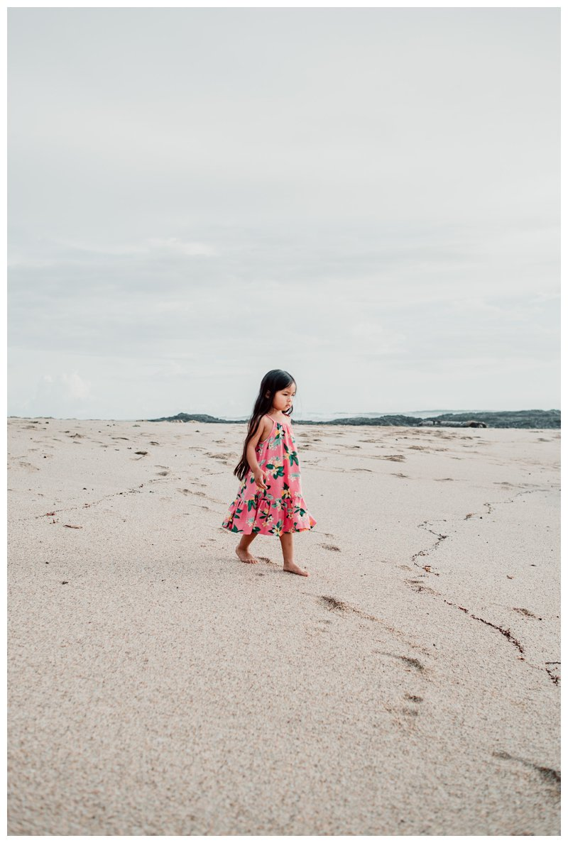 Little girl walking on the beach in Costa Rica. Calu Luna Playa Langosta Costa Rica family photos. Photographed by Kristen M. Brown, Samba to the Sea Photography.