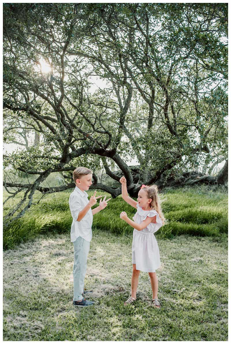 Kids playing during family photos in Kiawah Island SC. Photographed by Kristen M. Brown, Samba to the Sea Photography.