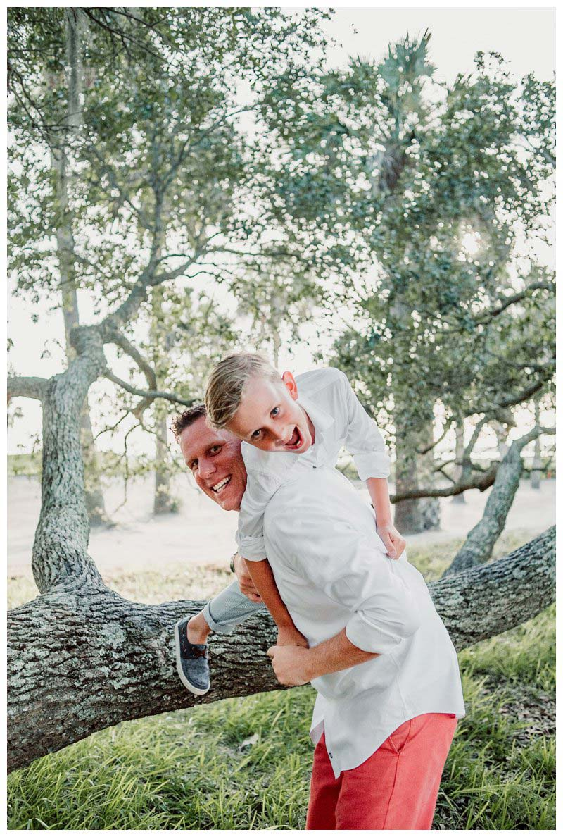 Boy playing with his dad during family photos in Kiawah Island SC. Photographed by Kristen M. Brown, Samba to the Sea Photography.
