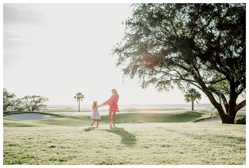 Mom dancing with her daughter during family photos in Kiawah Island SC. Photographed by Kristen M. Brown, Samba to the Sea Photography.