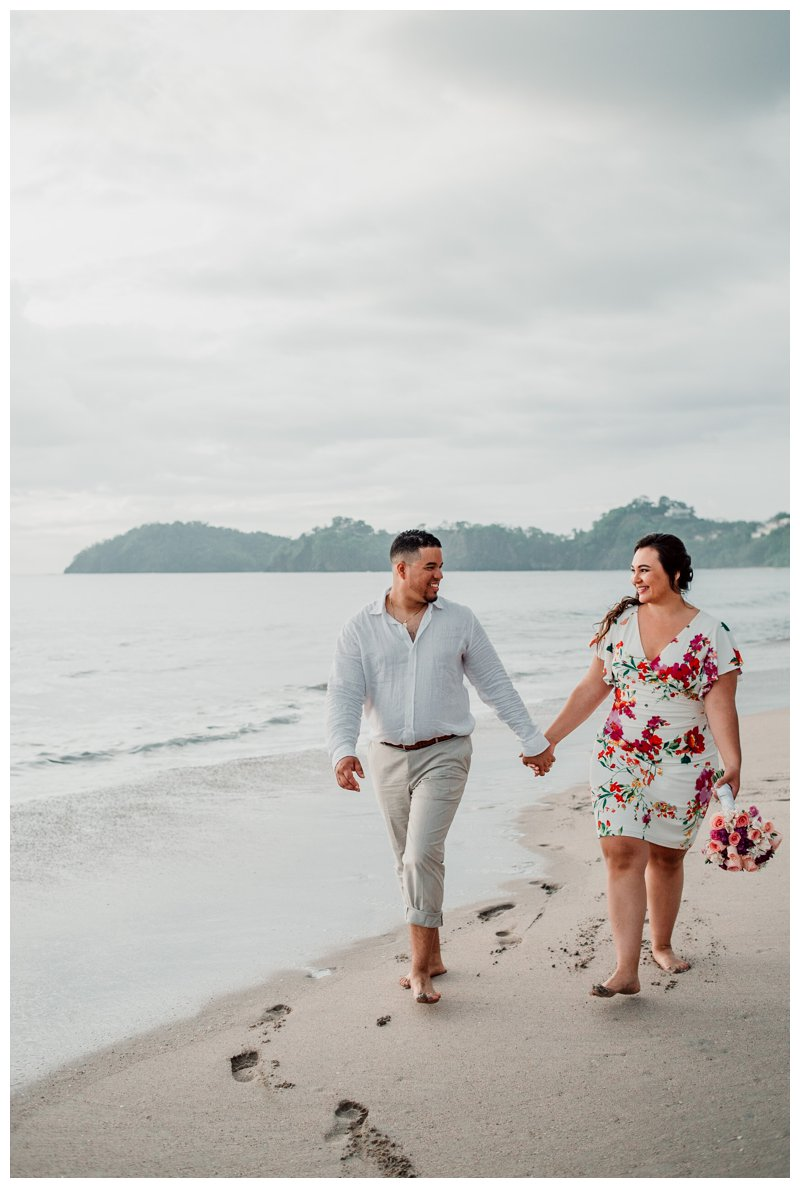 Bride and groom on the beach in Playa Flamingo Costa Rica. Costa Rica elopement by Playa Flamingo Costa Rica photographer Kristen M. Brown, Samba to the Sea Photography.