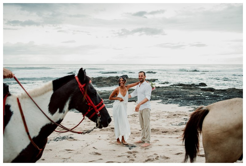 Hhorse photobombing a boho beach elopement in Costa Rica. Photographed by Kristen M. Brown, Samba to the Sea Photography.