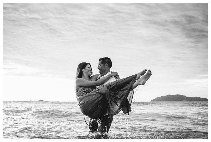 Couple playing in the ocean during honeymoon photos in Tamarindo Costa Rica. Photographed by Kristen M. Brown, Samba to the Sea Photography.