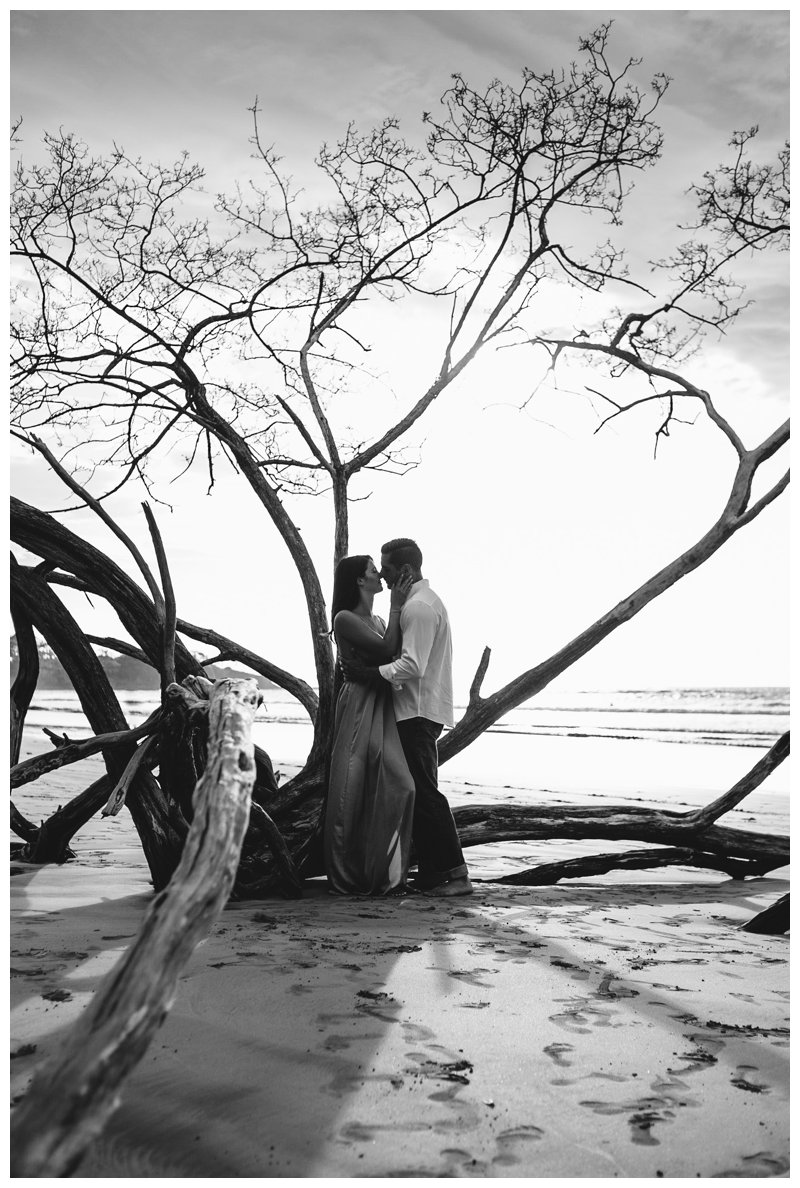 Couple kissing on the beach during honeymoon photos in Tamarindo Costa Rica. Photographed by Kristen M. Brown, Samba to the Sea Photography.