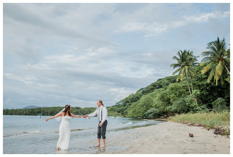 Couple dancing salsa during their Tamarindo Costa Rica beach elopement. Photographed by Kristen M. Brown, Samba to the Sea Photography.