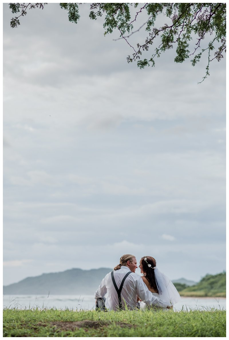 Couple kissing during their Tamarindo Costa Rica beach elopement. Photographed by Kristen M. Brown, Samba to the Sea Photography.