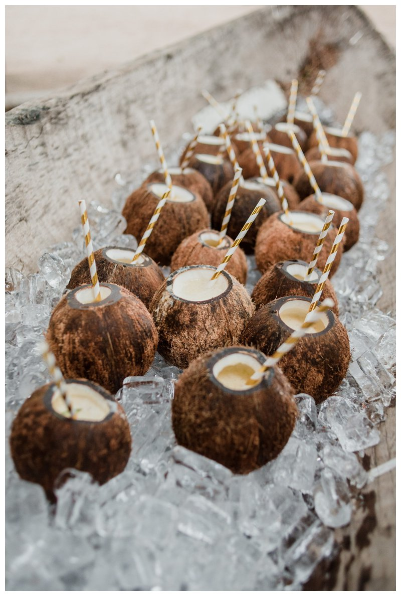 Coconut drinks at tropical wedding at Pangas Beach Club in Tamarindo Costa Rica. Photographed by Kristen M. Brown, Samba to the Sea Photography.