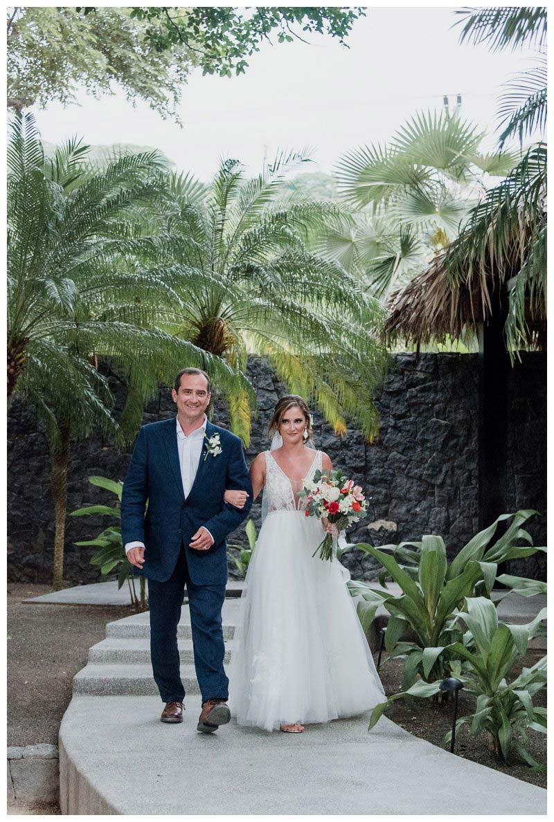 Father walking his daughter down the aisle at her tropical wedding at Pangas Beach Club in Tamarindo Costa Rica. Photographed by Kristen M. Brown, Samba to the Sea Photography.