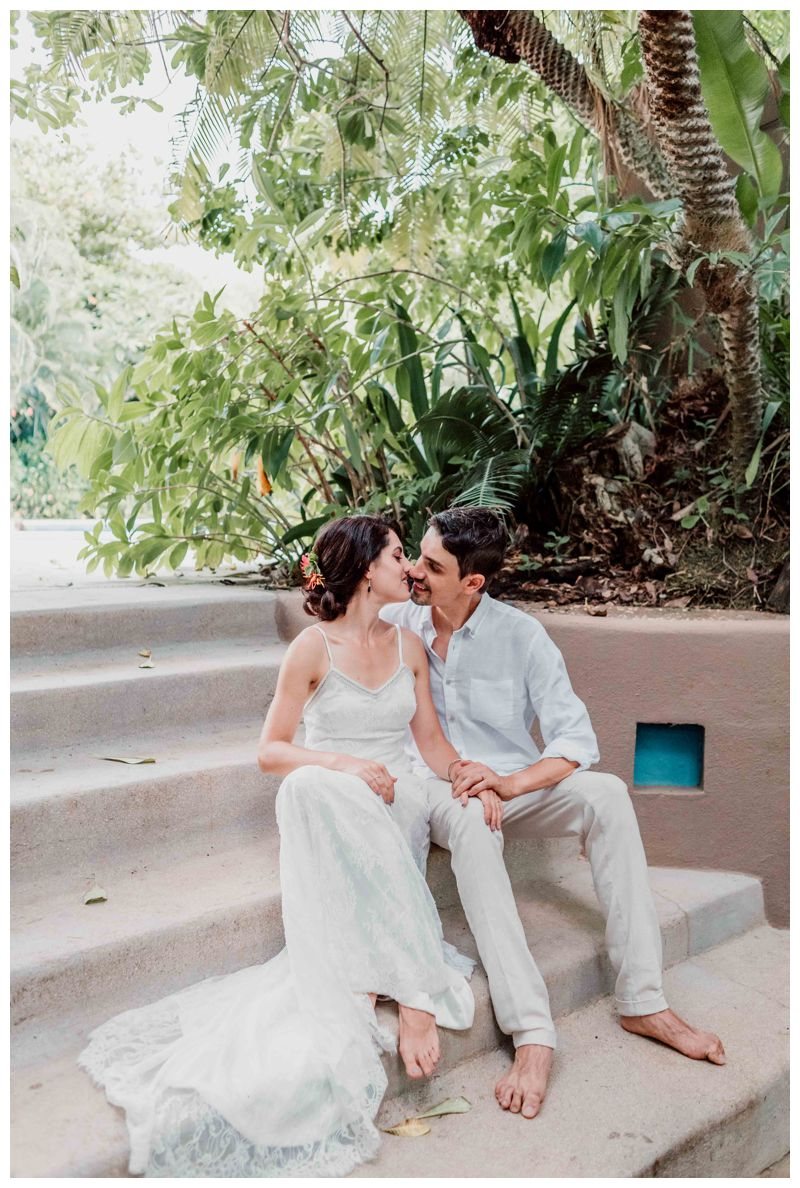 Bride and groom kissing at Cala Luna Boutique after their beach elopement in Playa Langosta Costa Rica. Photographed by Kristen M. Brown, Samba to the Sea Photography.