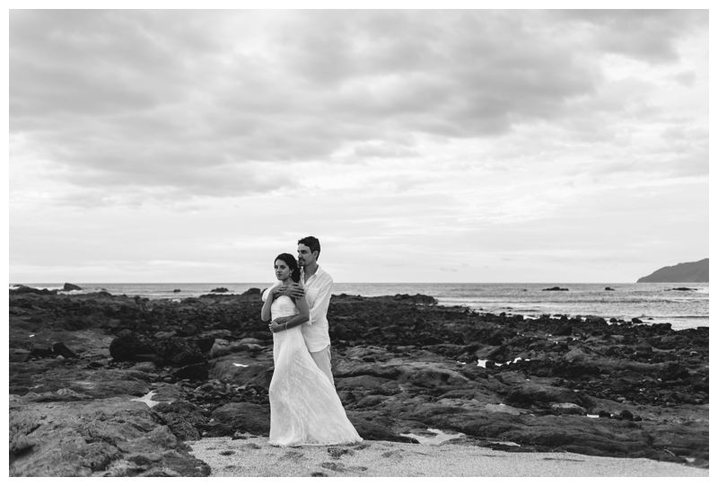 Bride and groom on the beach after their beach elopement in Playa Langosta Costa Rica. Photographed by Kristen M. Brown, Samba to the Sea Photography.