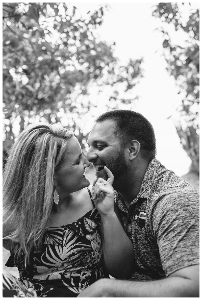 Husband and wife laughing during lifestyle photos in Tamarindo Costa Rica. Photographed by Kristen M. Brown, Samba to the Sea Photography.