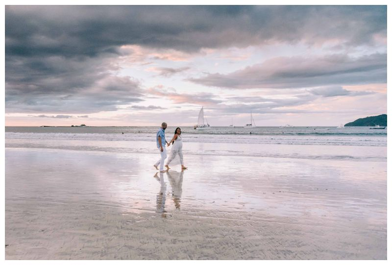 Couple walking on the beach in Tamarindo Costa Rica during sunset. Photographed by Kristen M. Brown, Samba to the Sea Photography.