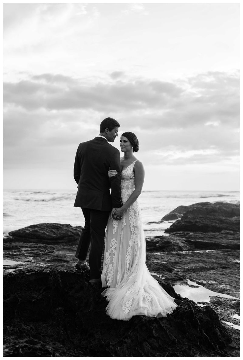 Black and white photo of bride and groom on the beach during sunset in Costa Rica. Beach wedding in Tamarindo Costa Rica at Langosta Beach Club photographed by Kristen M. Brown, Samba to the Sea Photography.