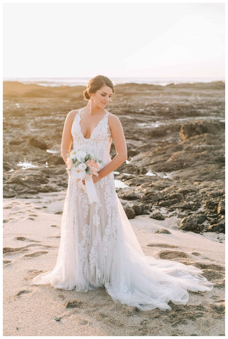 Bridal portrait on the beach in Costa Rica. Bride is wearing a Justin Alexander dress. Beach wedding in Tamarindo Costa Rica at Langosta Beach Club photographed by Kristen M. Brown, Samba to the Sea Photography.