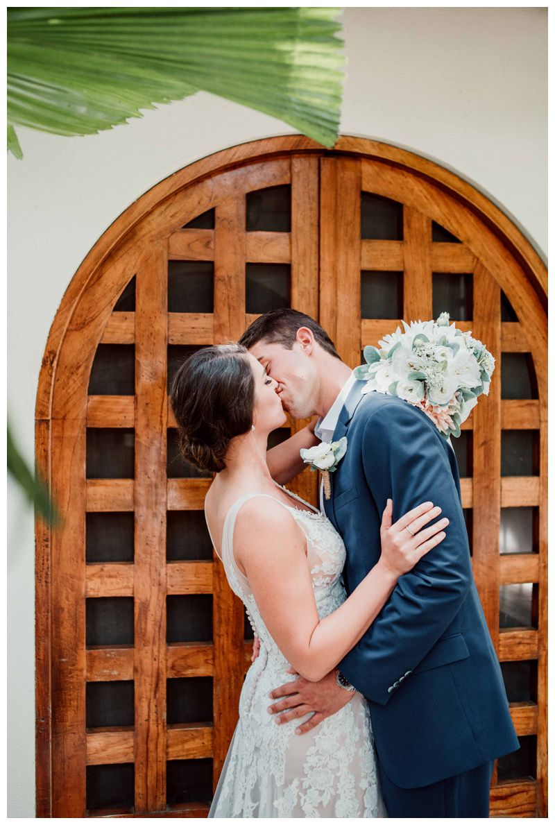 Bride and groom kissing at Casa Banyan in Tamarindo Costa Rica. Beach wedding in Tamarindo Costa Rica at Langosta Beach Club photographed by Kristen M. Brown, Samba to the Sea Photography.