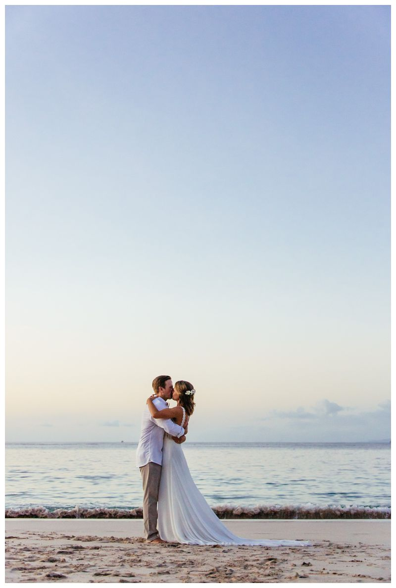 Bride and groom kissing on the beach. Wedding portraits on the beach in Costa Rica. Beach wedding in Playa Conchal Costa Rica photographed by Kristen M. Brown, Samba to the Sea Photography.