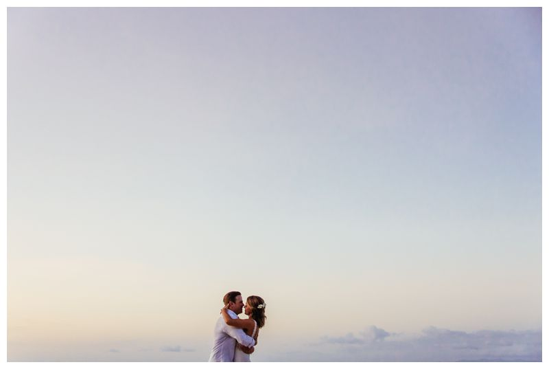 Bride and groom kissing on the beach on the beach during sunset . Wedding portraits on the beach in Costa Rica. Beach wedding in Playa Conchal Costa Rica photographed by Kristen M. Brown, Samba to the Sea Photography.