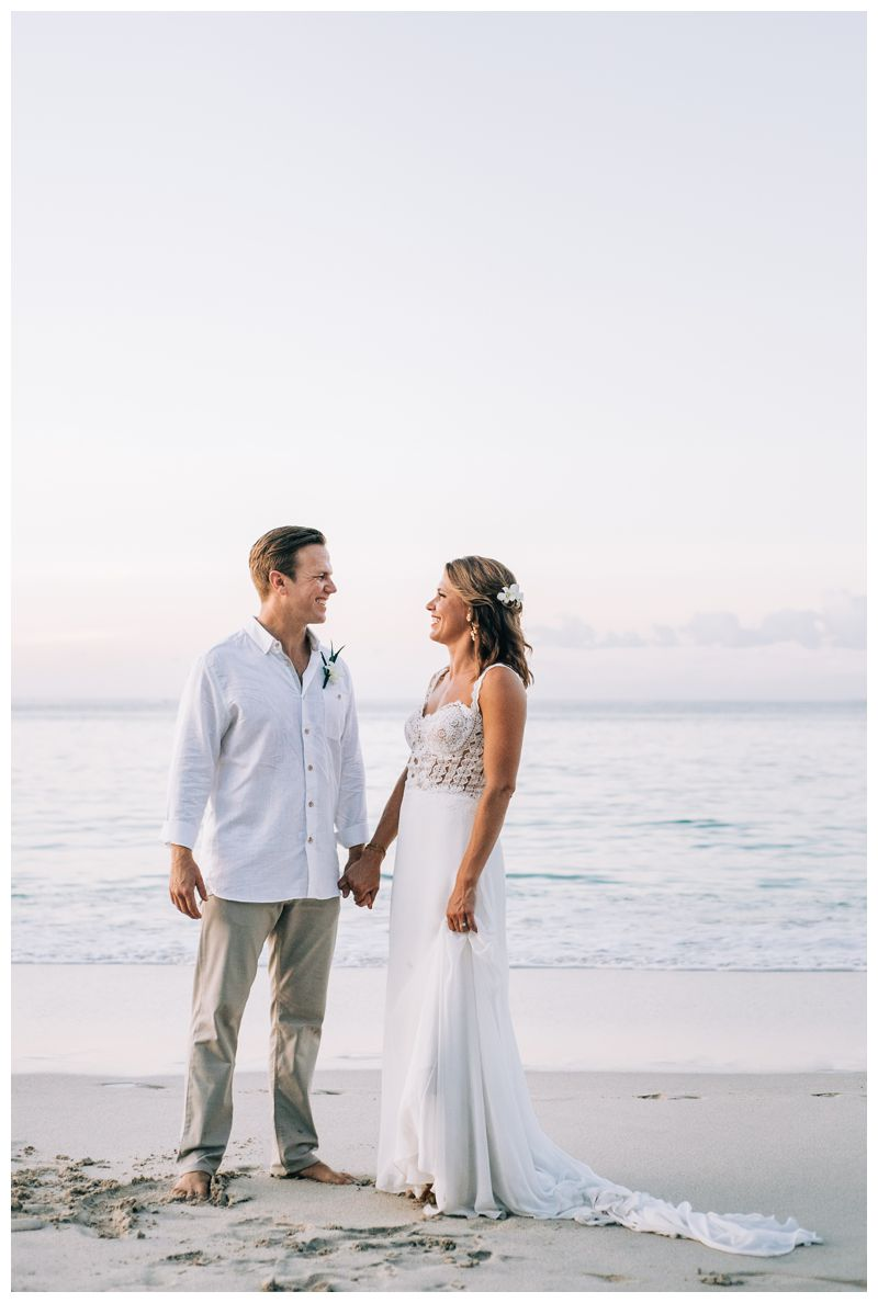Bride and groom laughing on the beach. Wedding portraits on the beach in Costa Rica. Beach wedding in Playa Conchal Costa Rica photographed by Kristen M. Brown, Samba to the Sea Photography.