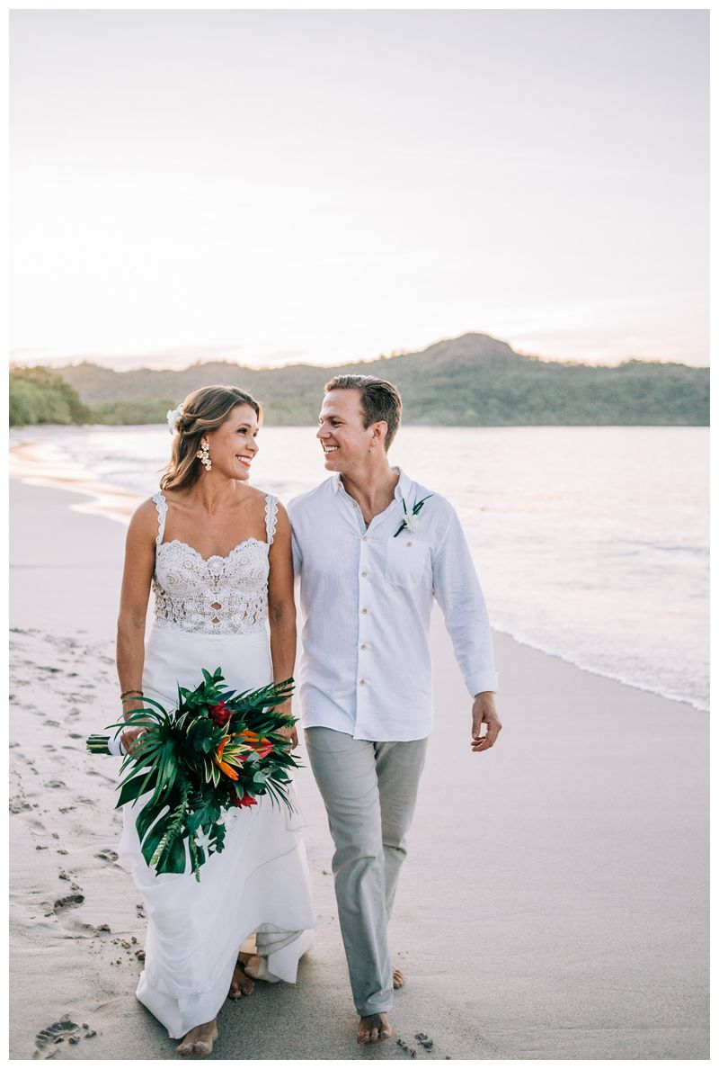 Bride and groom walking on the beach. Wedding portraits on the beach in Costa Rica. Beach wedding in Playa Conchal Costa Rica photographed by Kristen M. Brown, Samba to the Sea Photography.